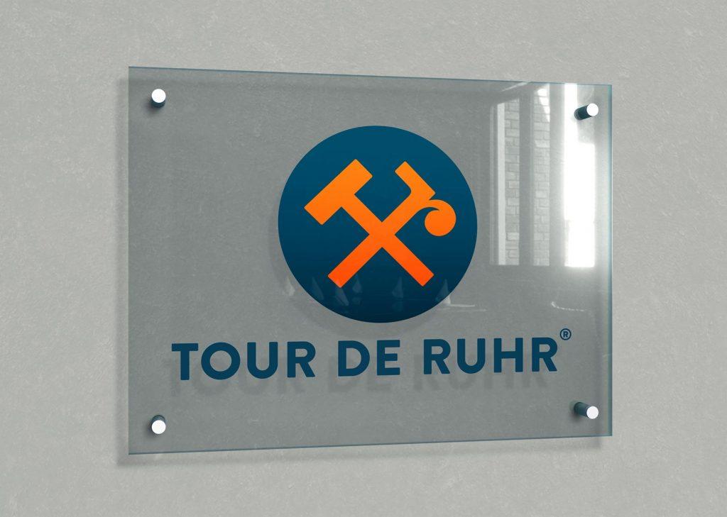 trommer tour de ruhr glass logo wall 2021